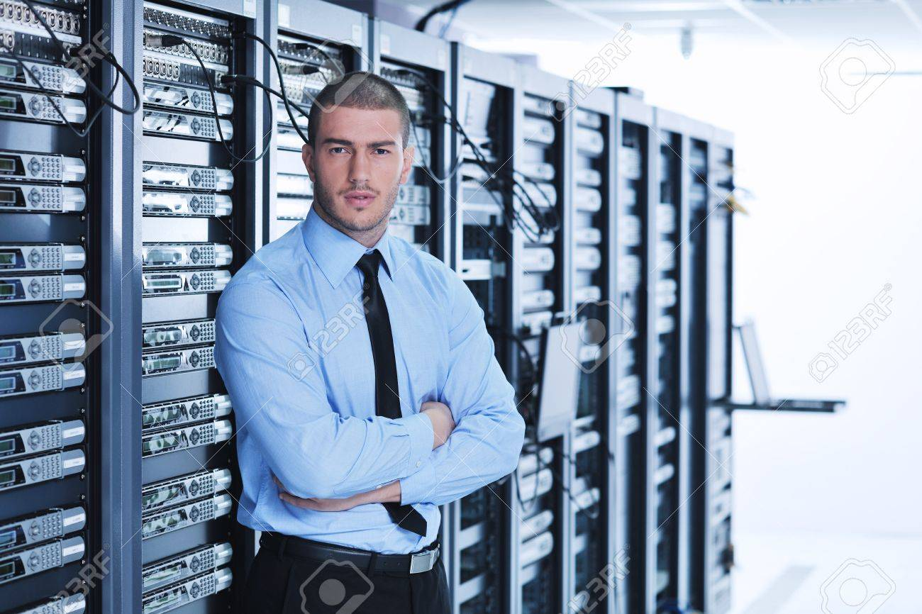 young handsome business man  engeneer in datacenter server room Standard-Bild - 11022954