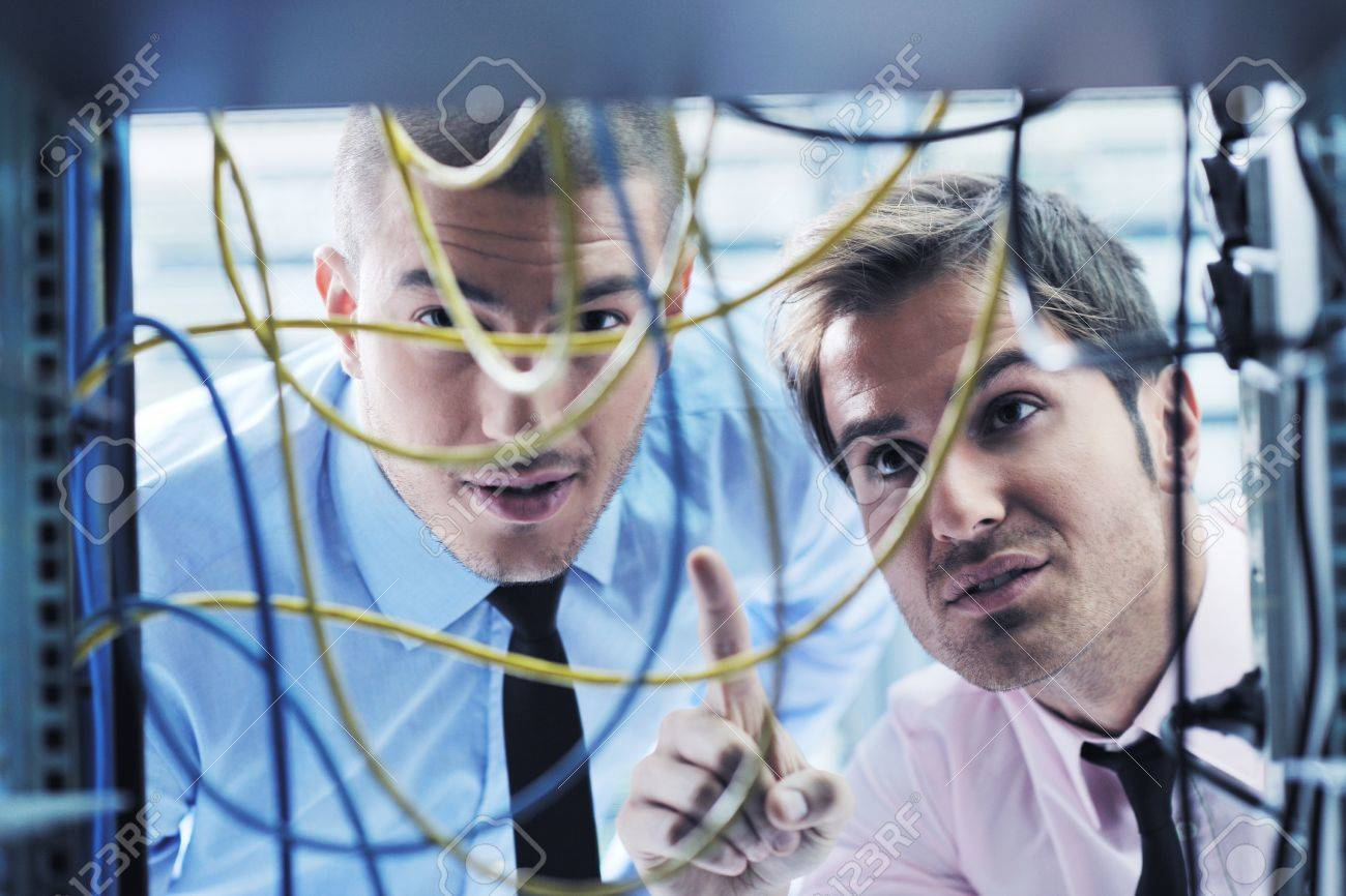 group of young business people it engineer in network server room solving problems and give help and support Stock Photo - 11022961