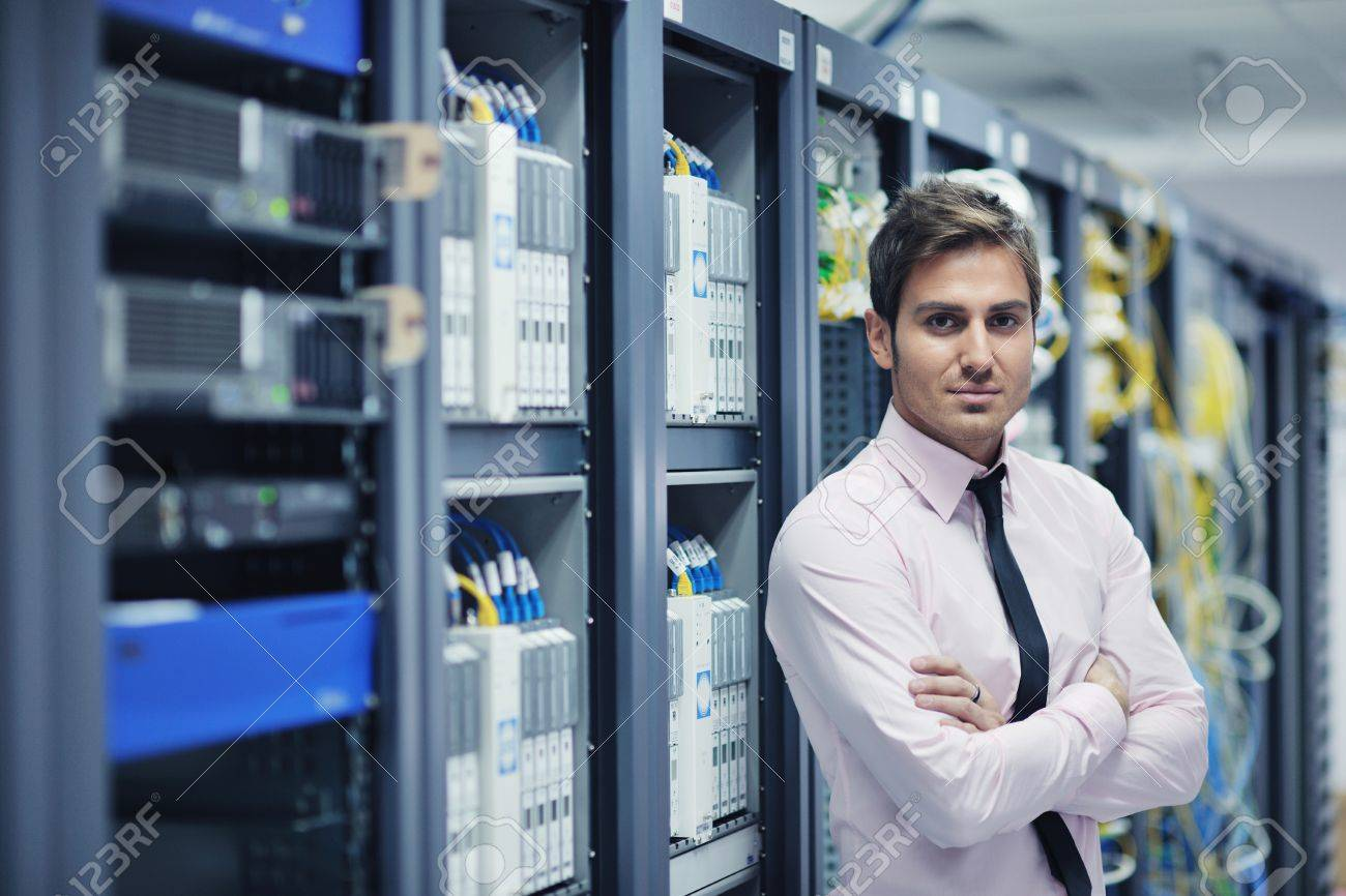 young handsome business man  engeneer in datacenter server room Stock Photo - 11022958