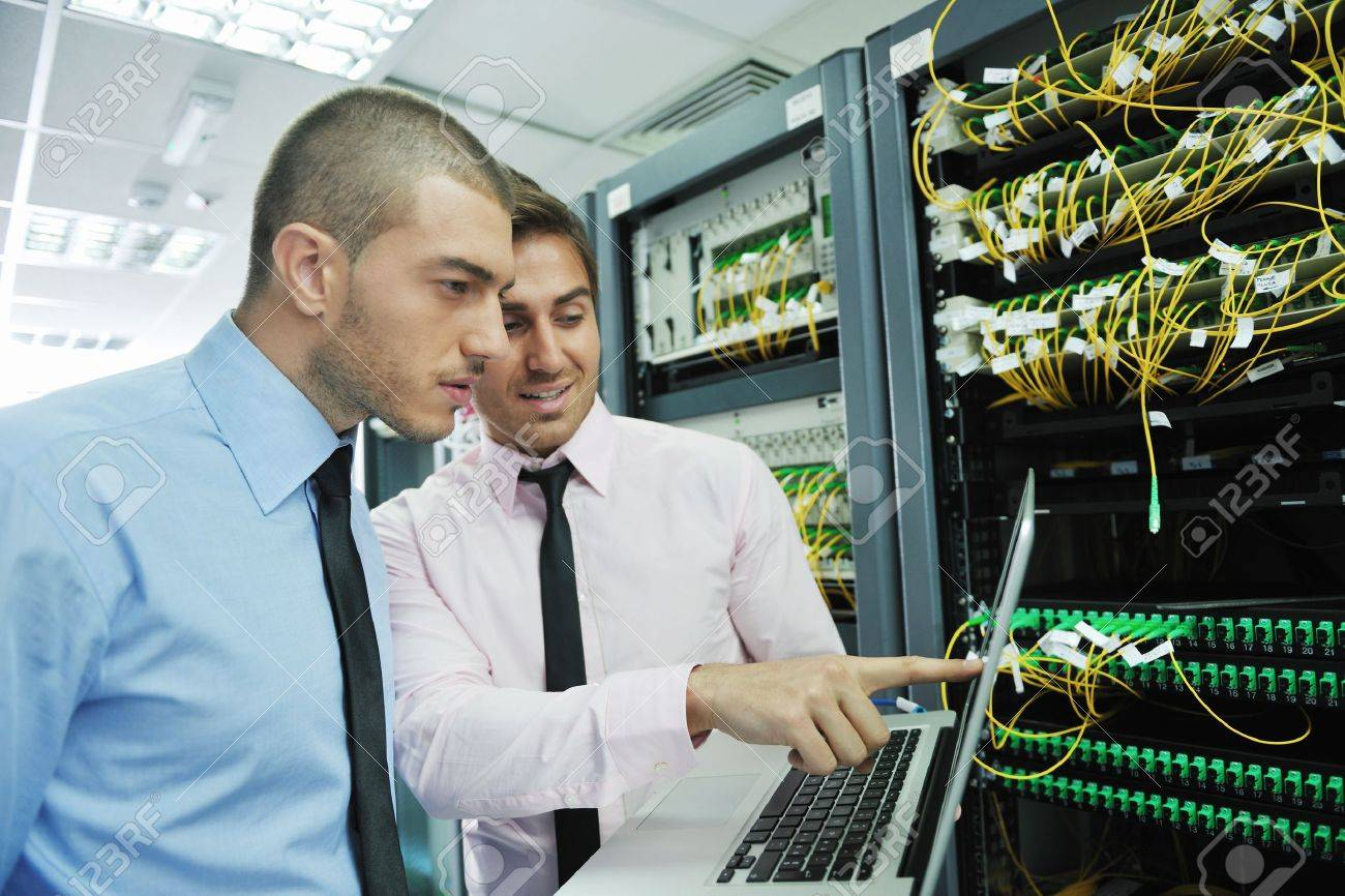 group of young business people it engineer in network server room solving problems and give help and support Stock Photo - 11023281