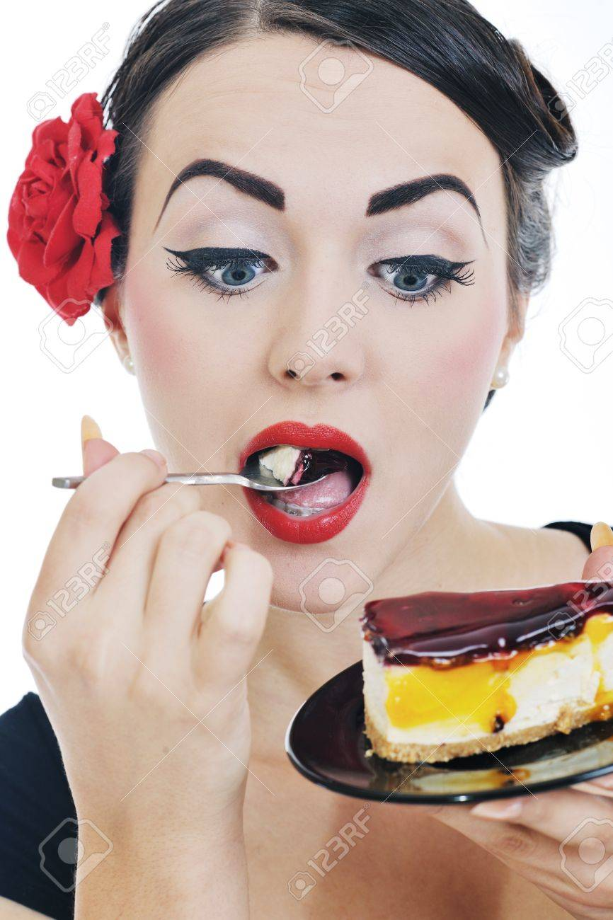 beautiful young retro pinup  woman eat sweet cake food isolated on white iin studio, representing diet and healthy concept Stock Photo - 11279183