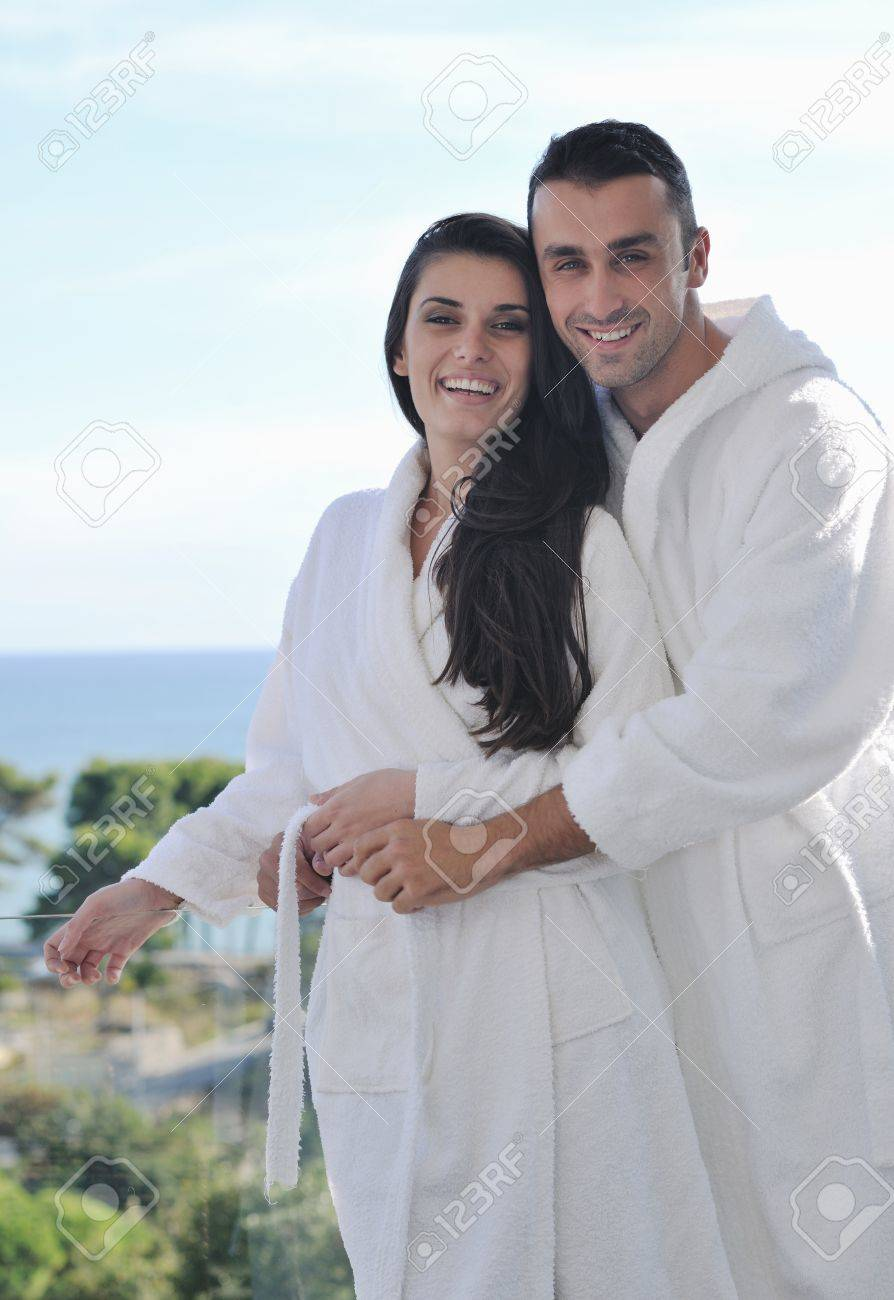happy young couple relax on balcony outdoor with ocean and blue sky in background Stock Photo - 11291662