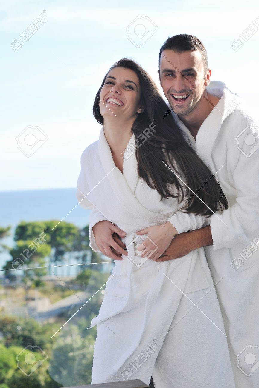 happy young couple relax on balcony outdoor with ocean and blue sky in background Stock Photo - 16393280