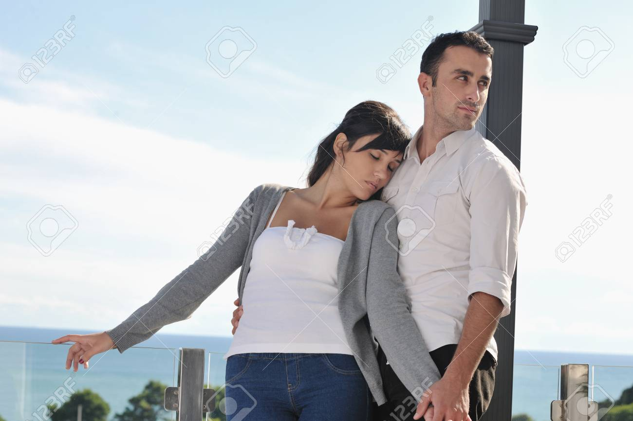 happy young couple in love have romance  relax on balcony outdoor with ocean and blue sky in background Stock Photo - 11398927