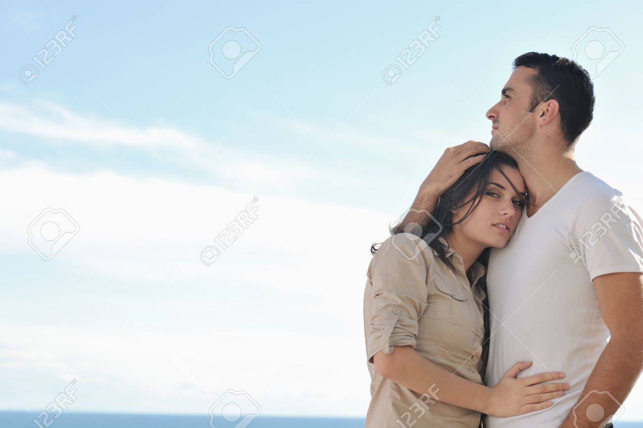 happy young couple in love have romance  relax on balcony outdoor with ocean and blue sky in background Stock Photo - 16393491