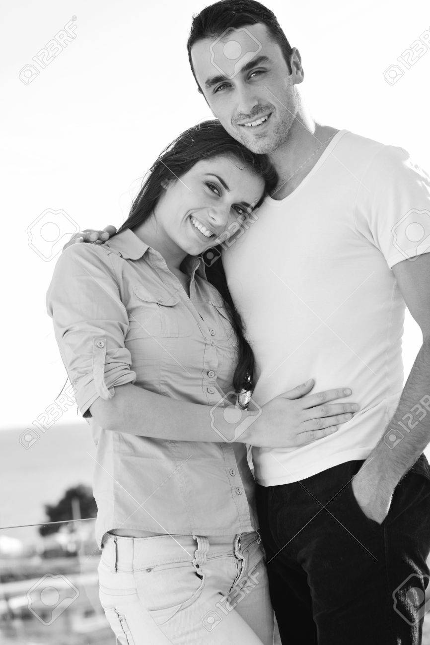 happy young couple in love have romance  relax on balcony outdoor with ocean and blue sky in background Stock Photo - 16393516