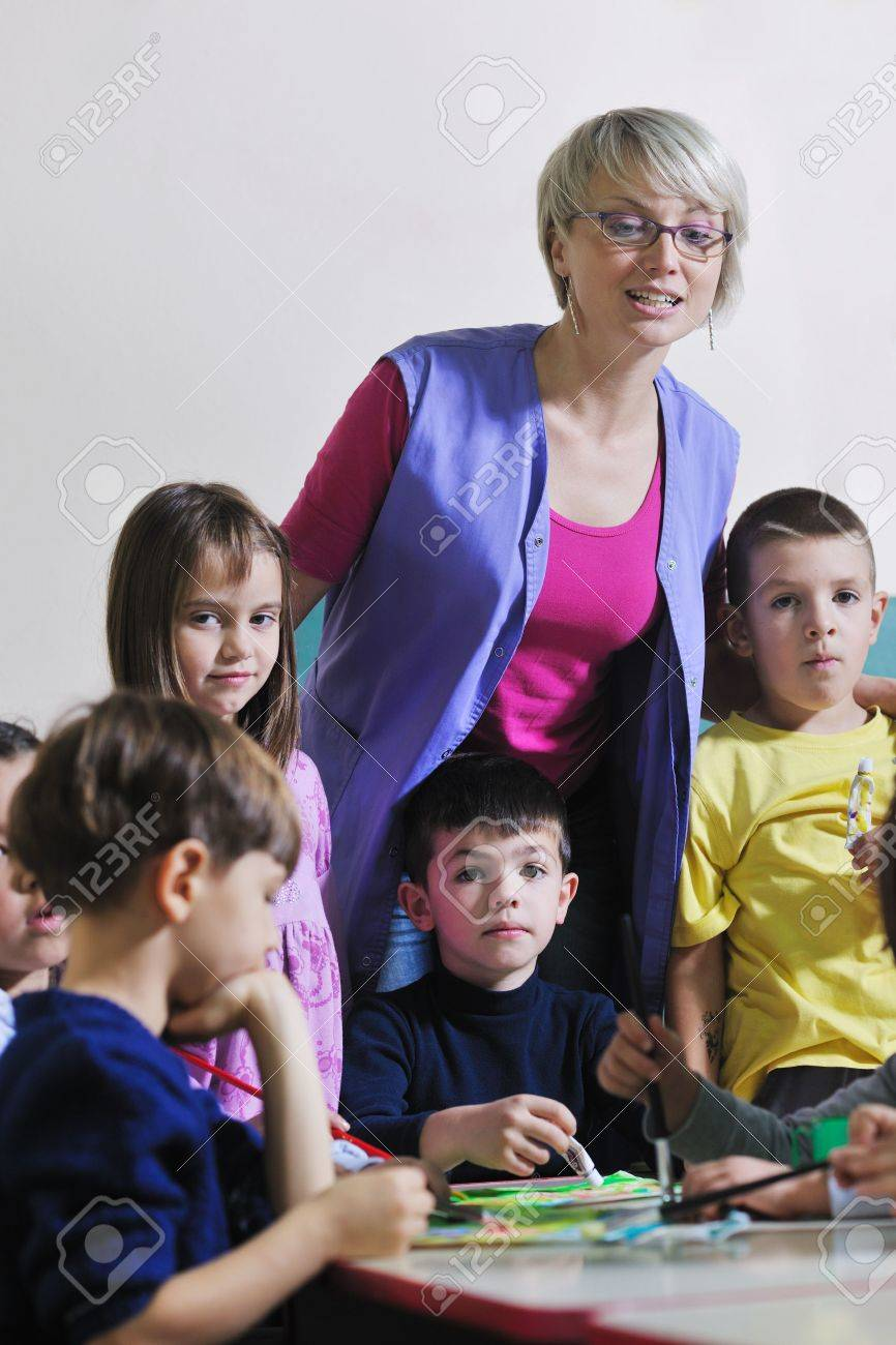 happy child kids group have fun and play at kindergarden indoor preschool education concept with  teacher Stock Photo - 11422906