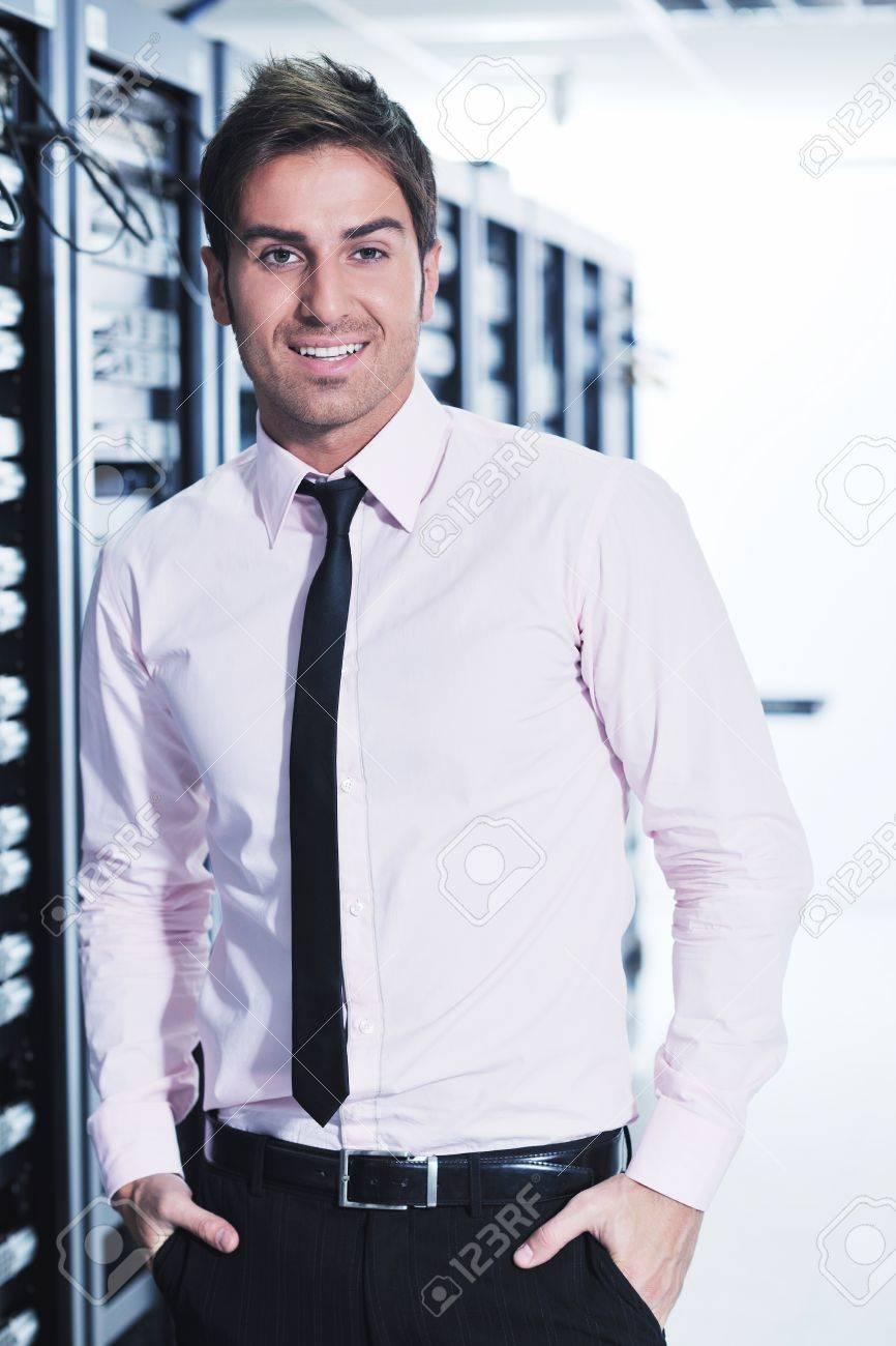 young handsome business man  engeneer in datacenter server room Stock Photo - 11465807