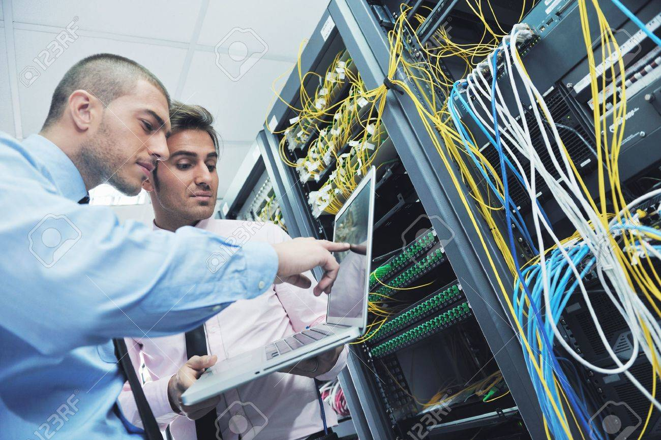 group of young business people it engineer in network server room solving problems and give help and support Stock Photo - 11399125