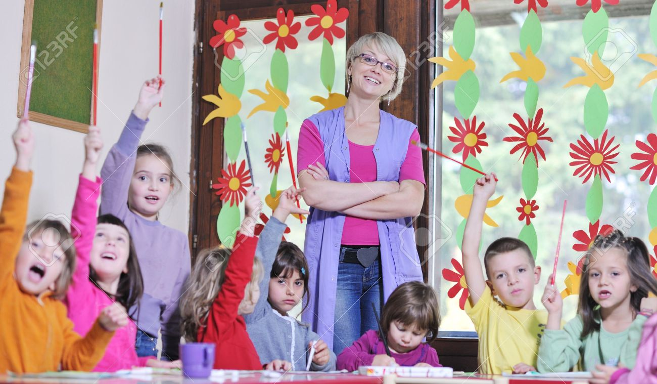 happy child kids group have fun and play at kindergarden indoor preschool education concept with  teacher Stock Photo - 11716171