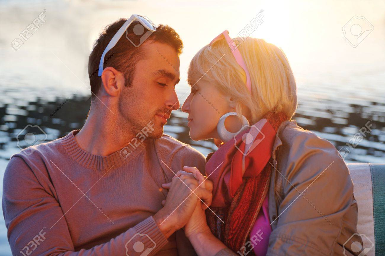 happy young couple in love  have romantic time at summer sunset   at ship boat while  representing urban and countryside fashin lifestyle Stock Photo - 12069678