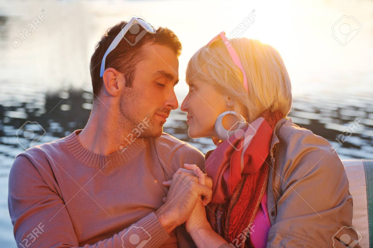 happy young couple in love  have romantic time at summer sunset   at ship boat while  representing urban and countryside fashin lifestyle Stock Photo - 12061334