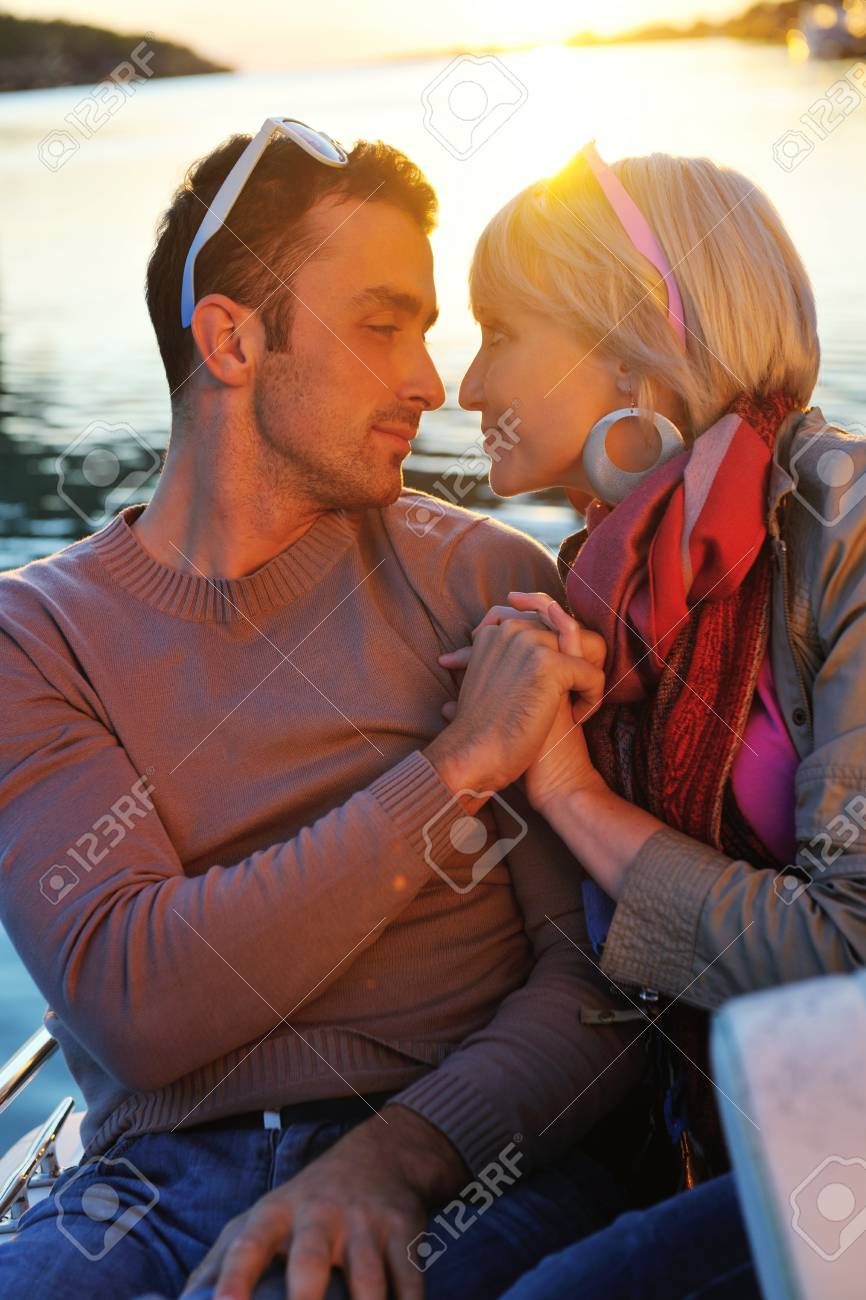 happy young couple in love  have romantic time at summer sunset   at ship boat while  representing urban and countryside fashin lifestyle Stock Photo - 12058296
