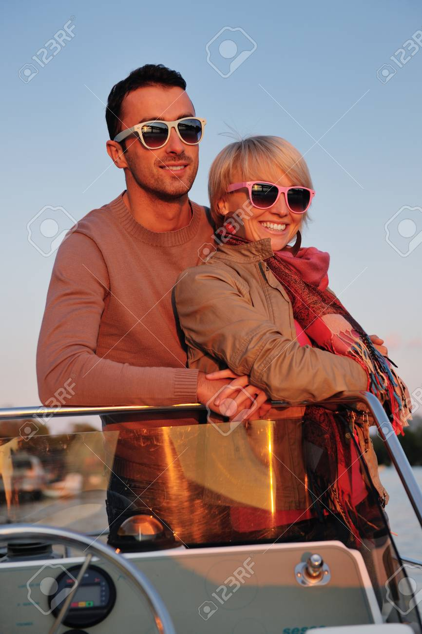 happy young couple in love  have romantic time at summer sunset   at ship boat while  representing urban and countryside fashin lifestyle Stock Photo - 12070088
