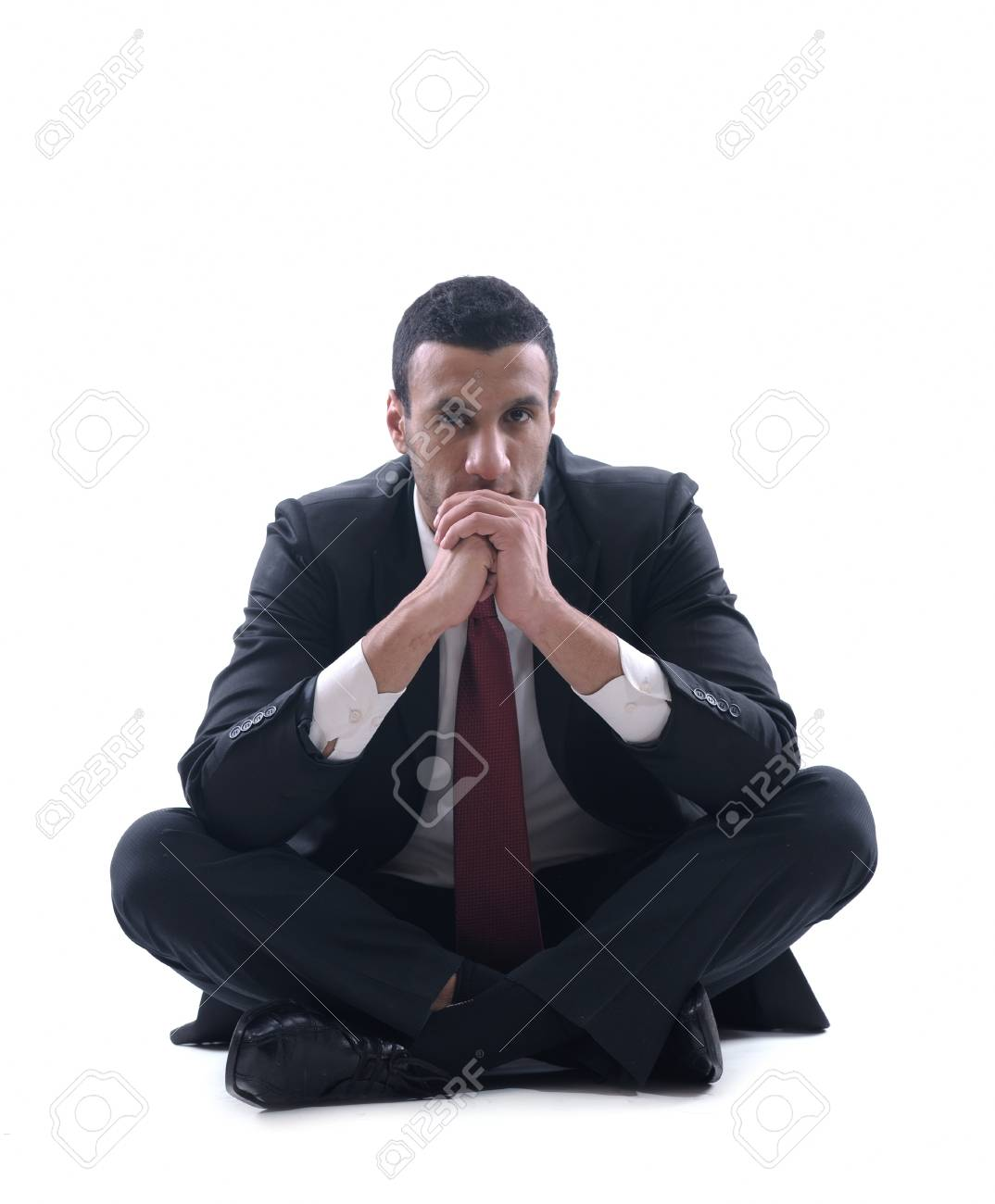 Portrait of a young business man looking depressed from work isolated over white background in studio Stock Photo - 12303783