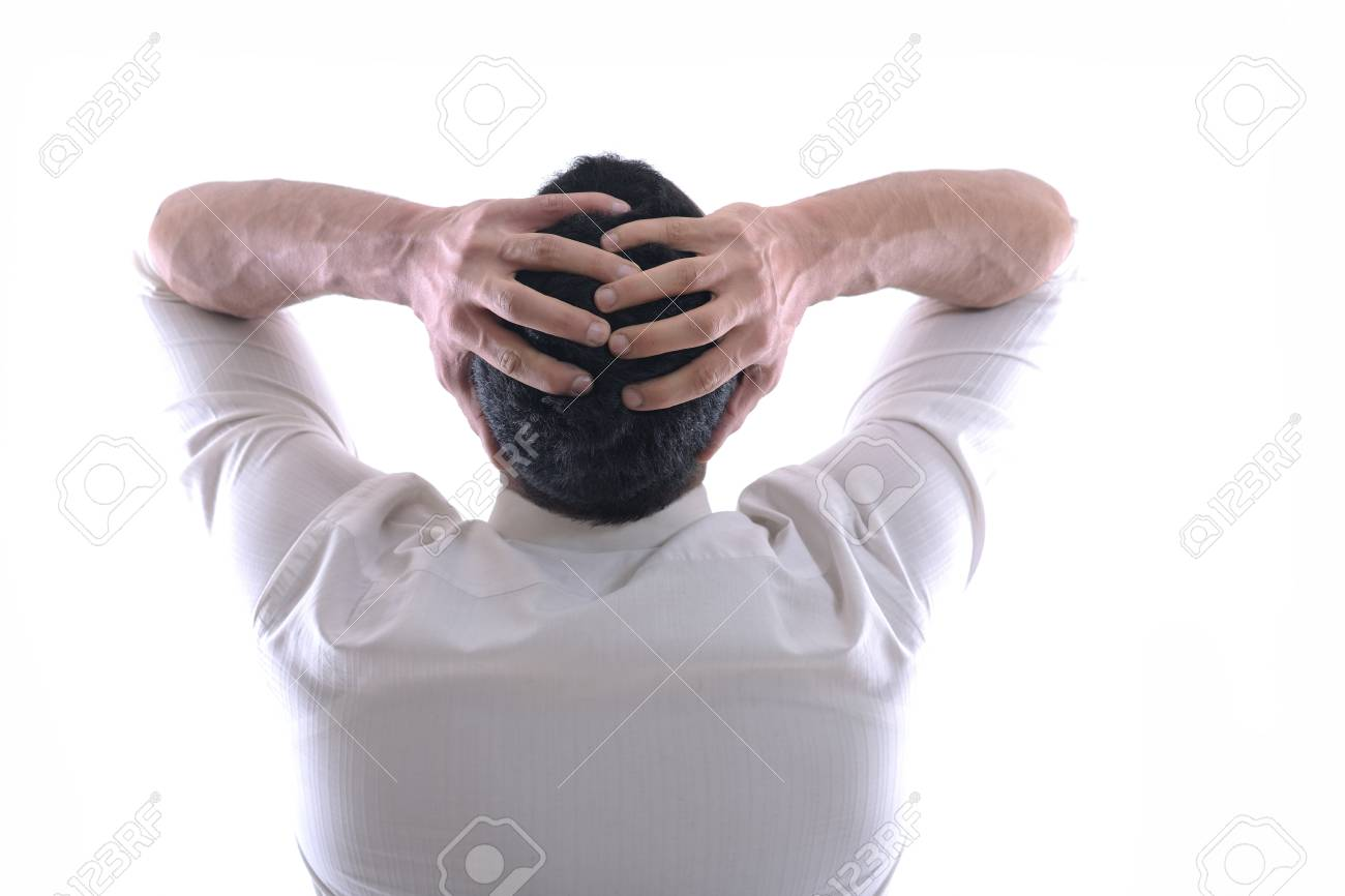Portrait of a young business man looking depressed from work isolated over white background in studio Stock Photo - 12303794