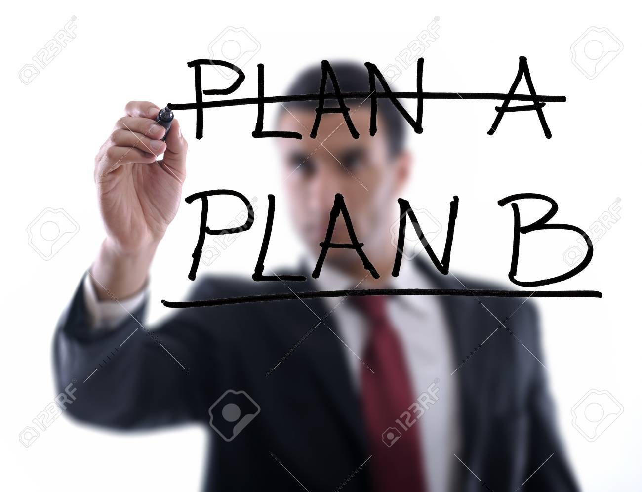 business man draw business solutions and plan b concept  with marker on glass  isolated on white background  in studio Stock Photo - 12303976