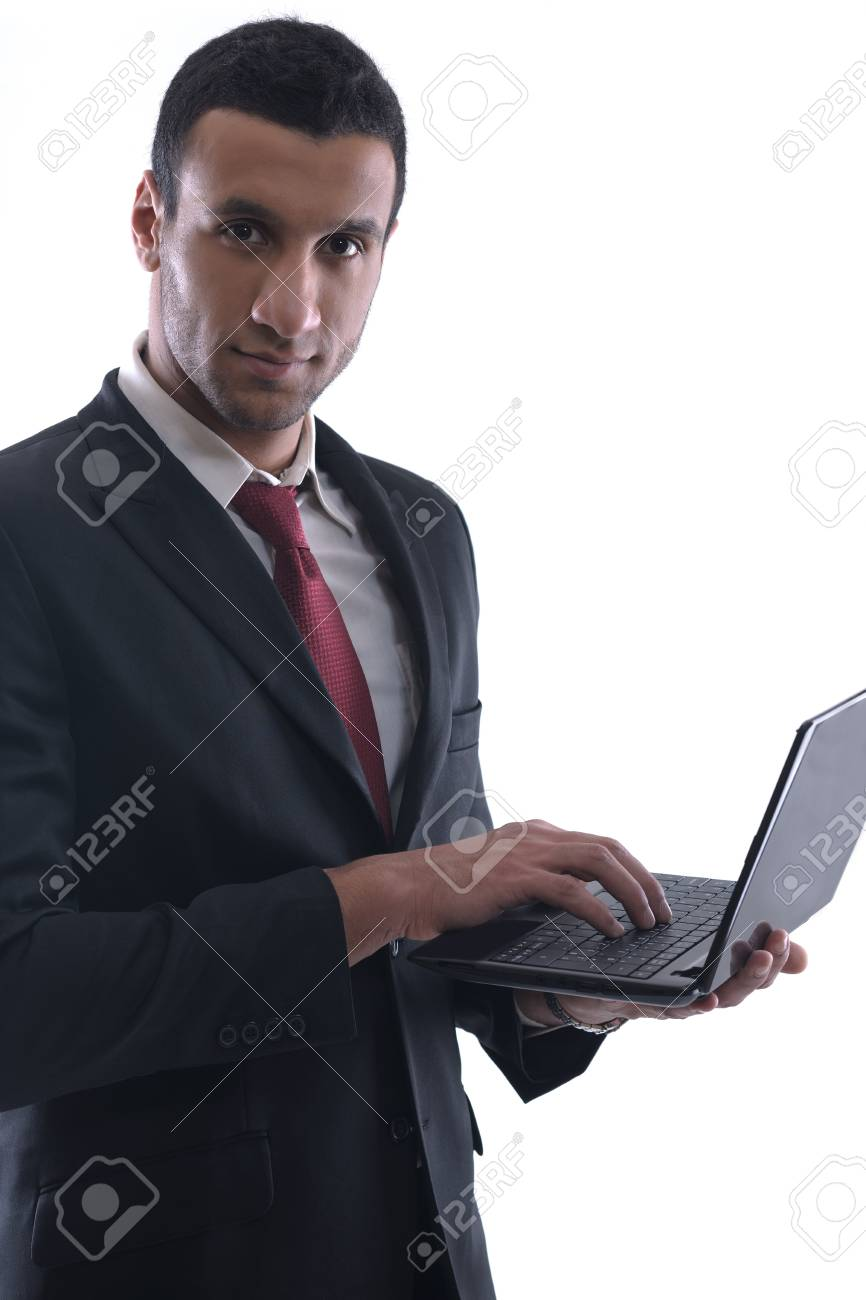 Smiling business man hold and work on mini laptop comuter   Isolated on white background in studio Stock Photo - 12565450