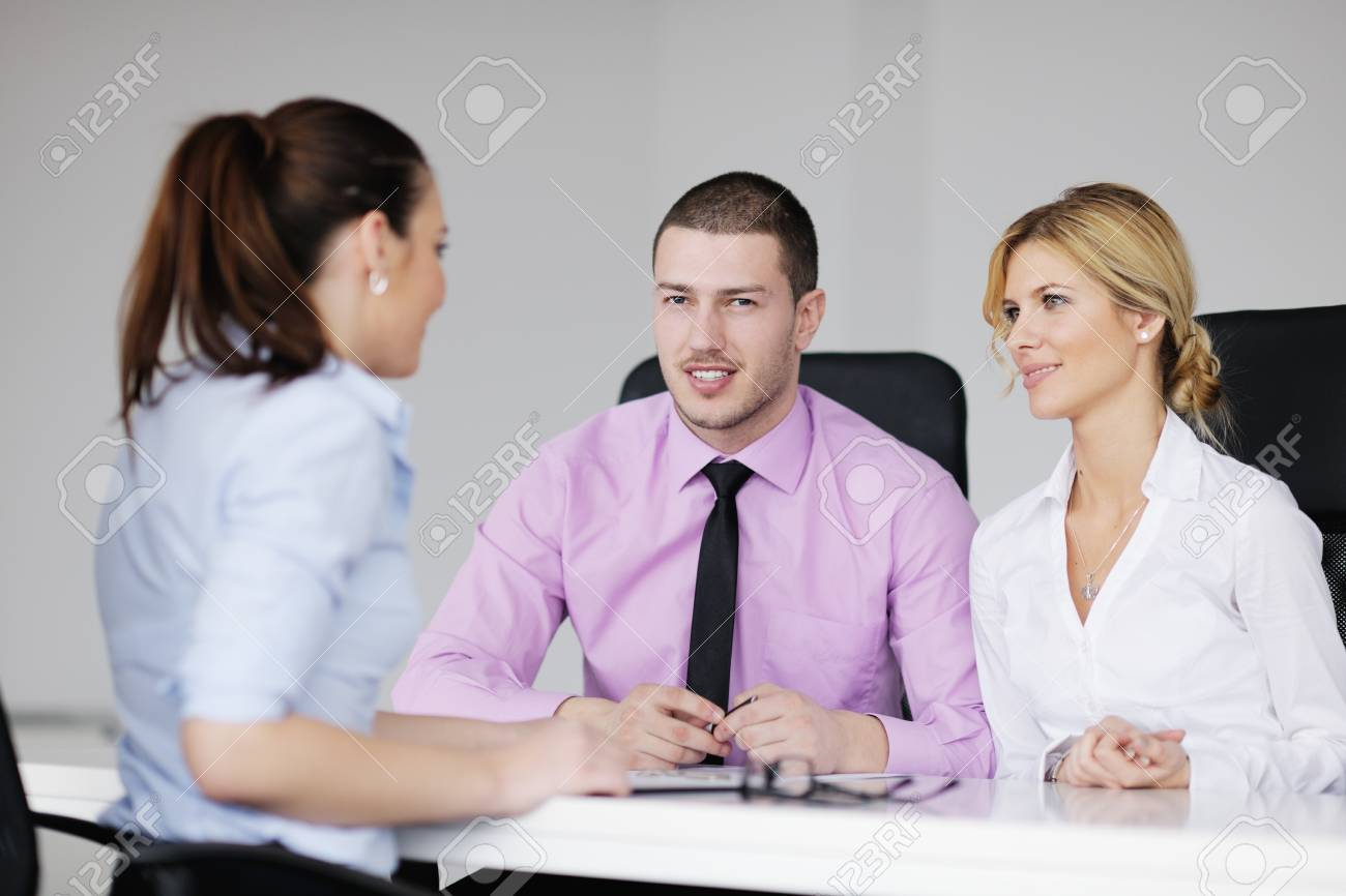 Group of young business people sitting in board room during meeting and discussing with paperwork Stock Photo - 12565166