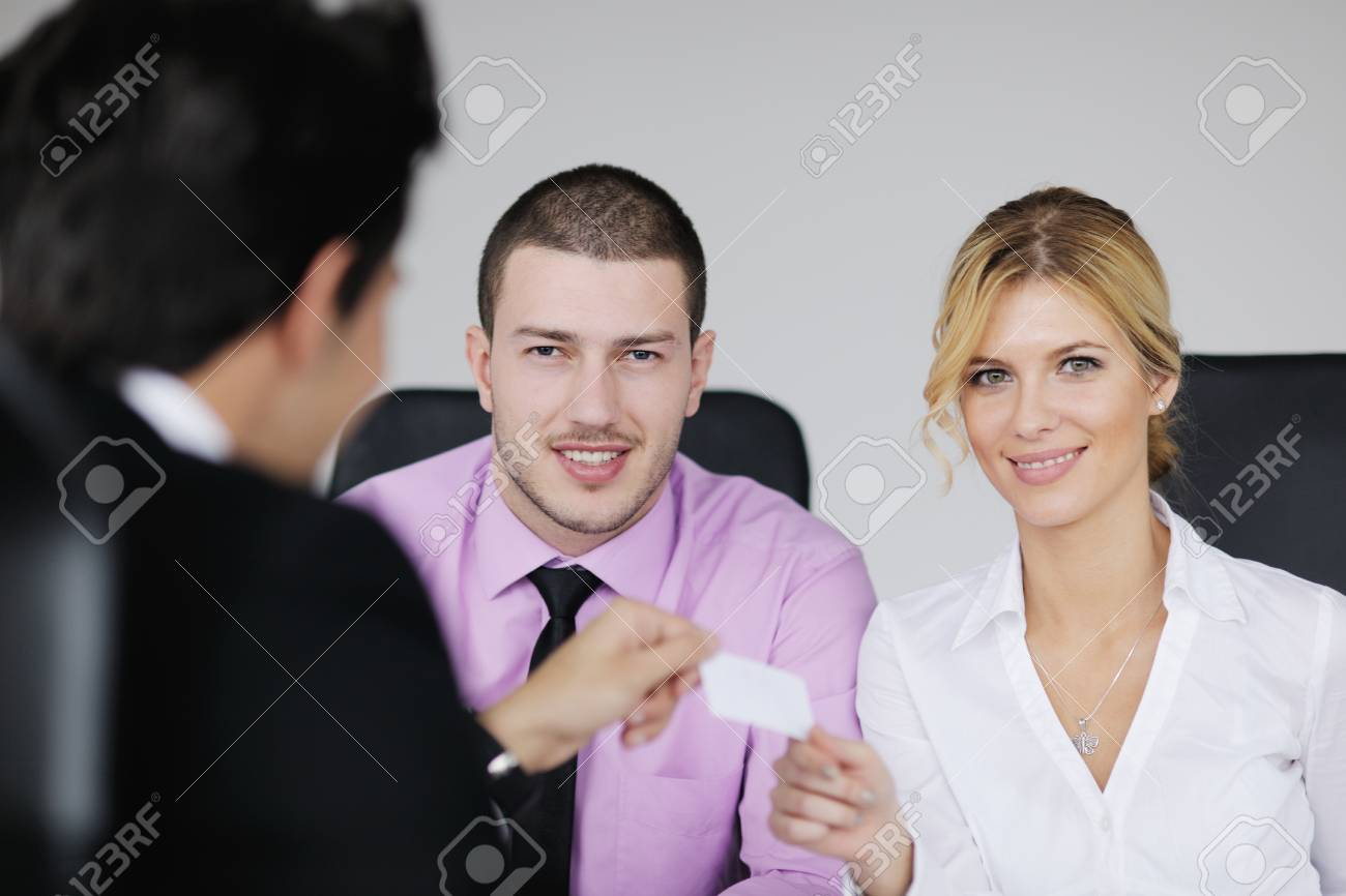 Group of young business people sitting in board room during meeting and discussing with paperwork Stock Photo - 12565148