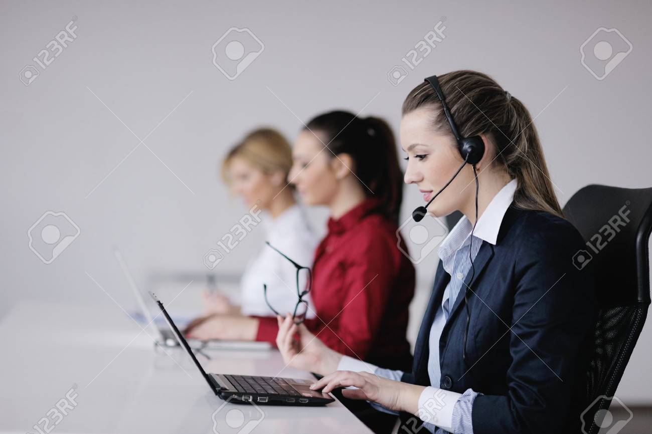 Pretty Young Business Woman Group With Headphones Smiling At