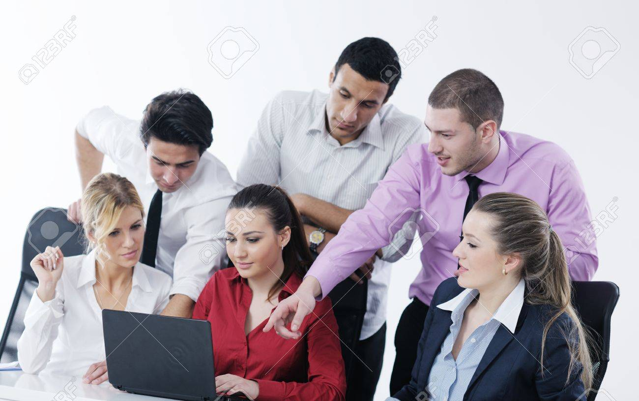 Group of young business people sitting in board room during meeting and discussing with paperwork Stock Photo - 12565210