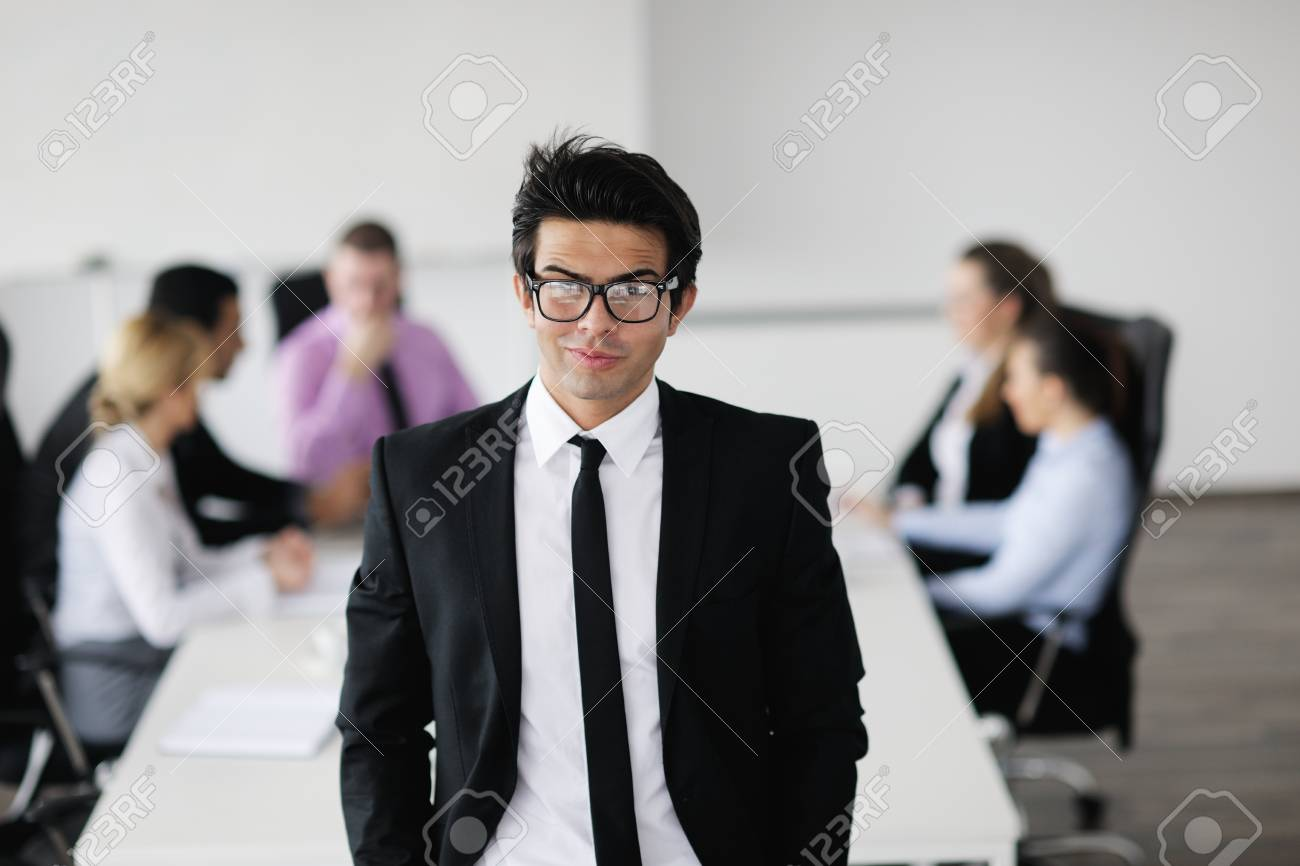Confident young business man attending a meeting with his colleagues Stock Photo - 12567939