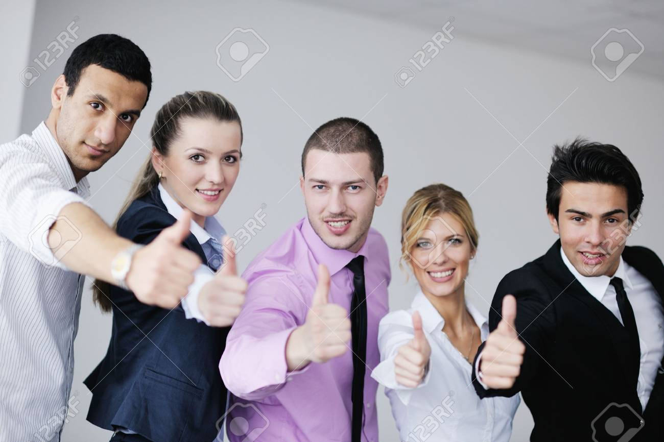 Group of young business people sitting in board room during meeting and discussing with paperwork Stock Photo - 12567563
