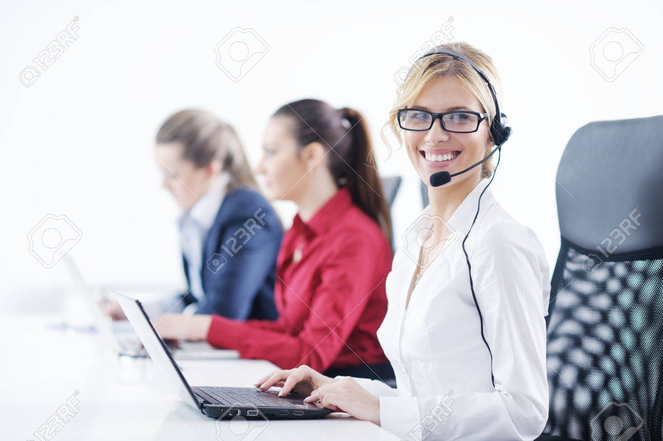 Pretty young business woman group with headphones smiling at you against white background Stock Photo - 12765814