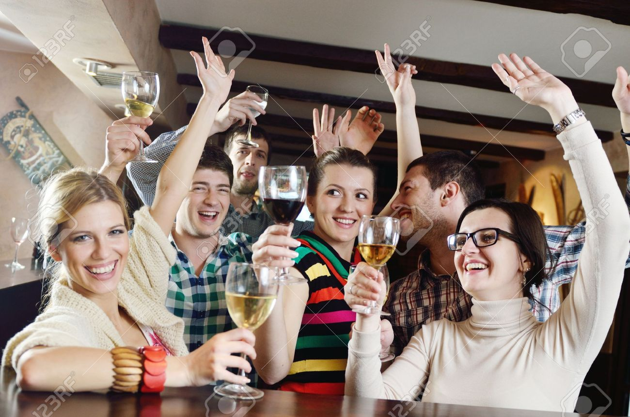 Group of happy young people drink wine  at party disco restaurant Stock Photo - 13112472