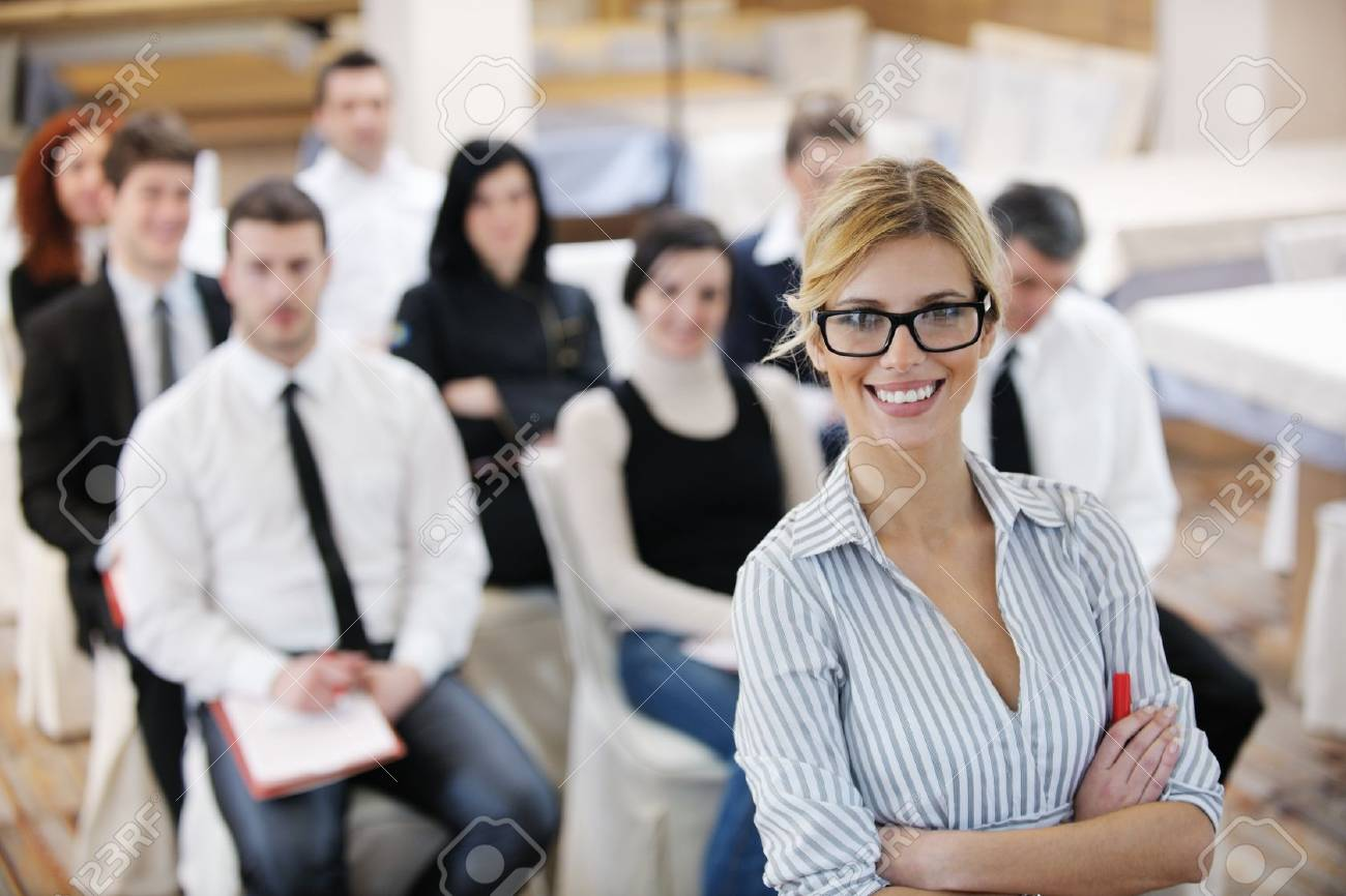 business woman standing with her staff in background at modern bright office conference room Stock Photo - 13112596
