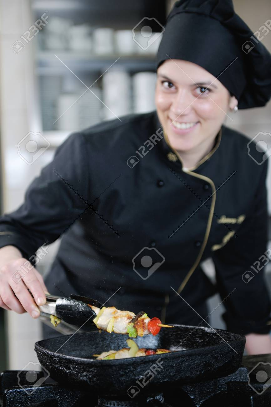 beautiful young chef woman prepare and decorating tasty food in kitchen Stock Photo - 13180738