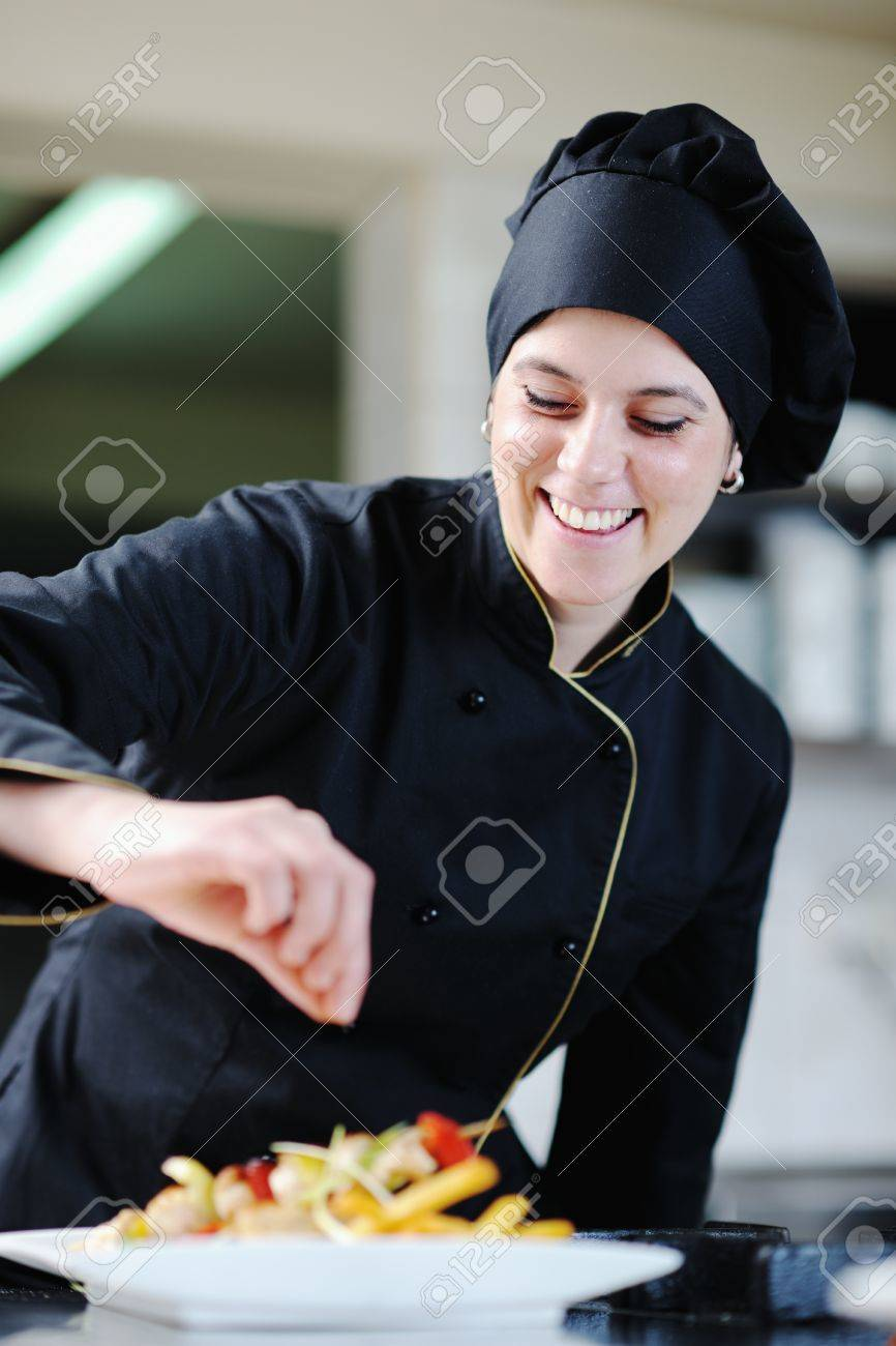 beautiful young chef woman prepare and decorating tasty food in kitchen Stock Photo - 13180542