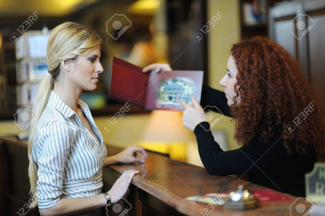 business woman  at the reception of a hotel checking in Stock Photo - 13402172