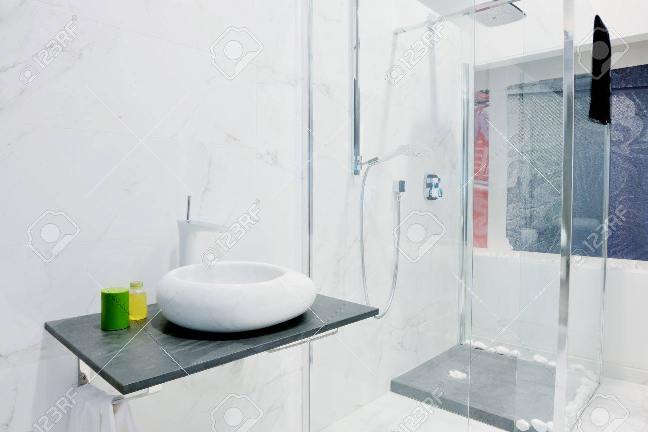 Small Bathroom Interior modern new small bathroom interior with bath tub. stock photo