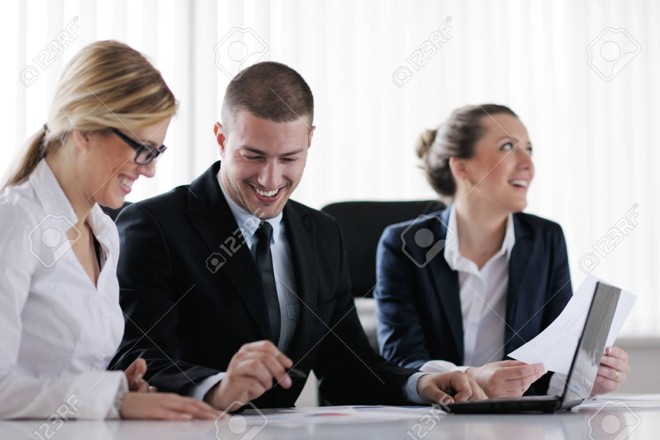 Group of happy young  business people in a meeting at office Stock Photo - 13578007
