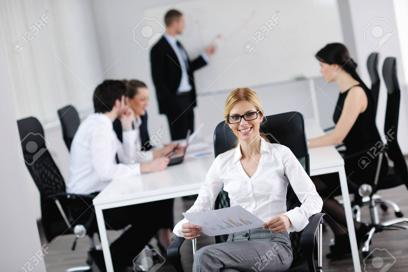 business woman  with her staff,  people group in background at modern bright office indoors Stock Photo - 13579424