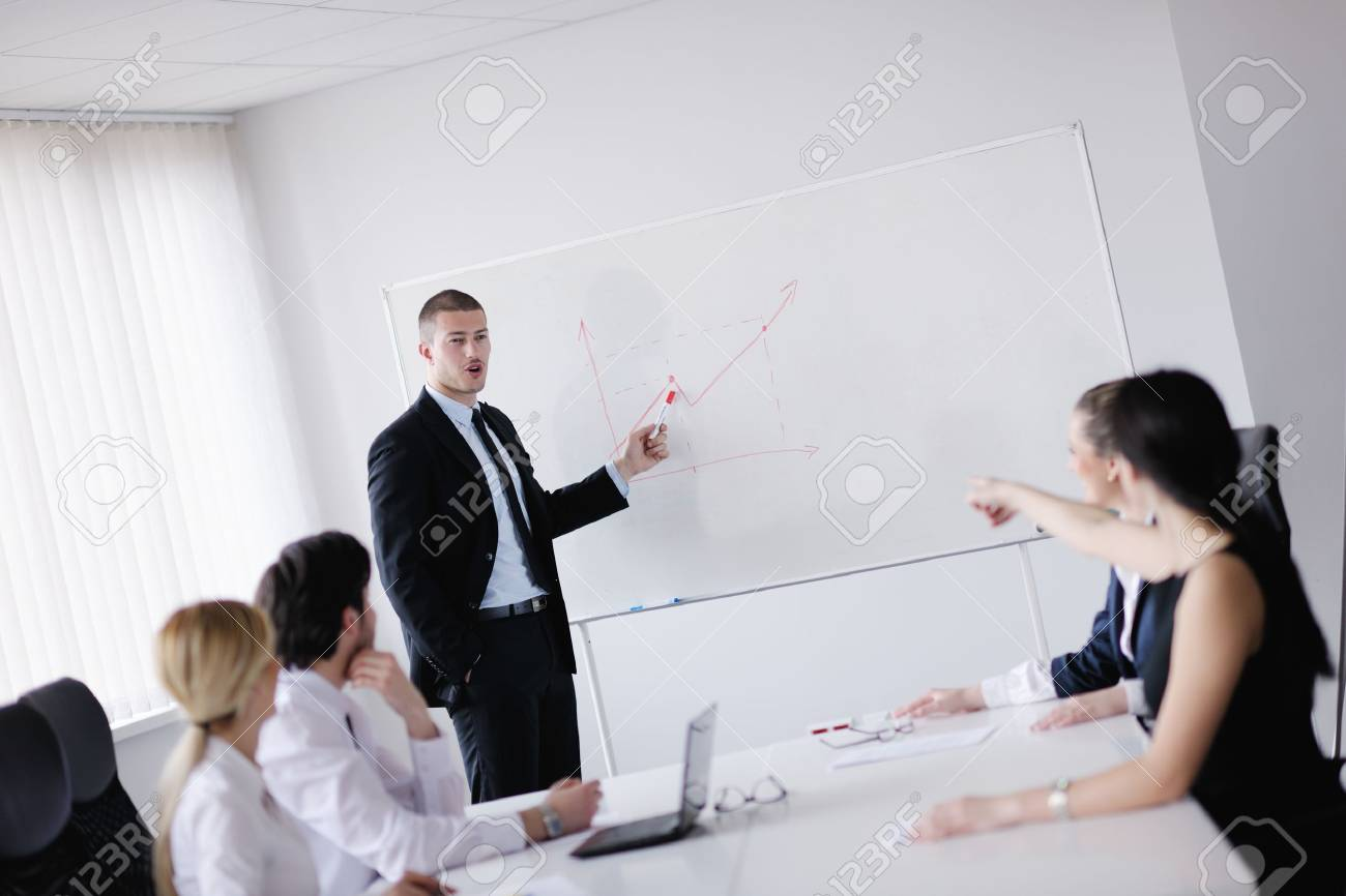Group of happy young  business people in a meeting at office Stock Photo - 13579839