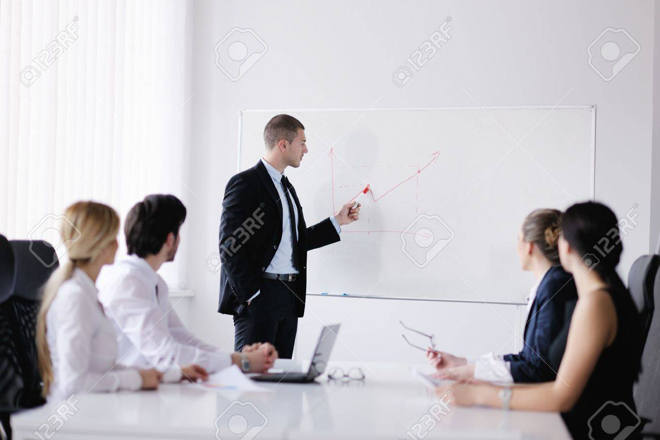 Group of happy young  business people in a meeting at office Stock Photo - 13628884