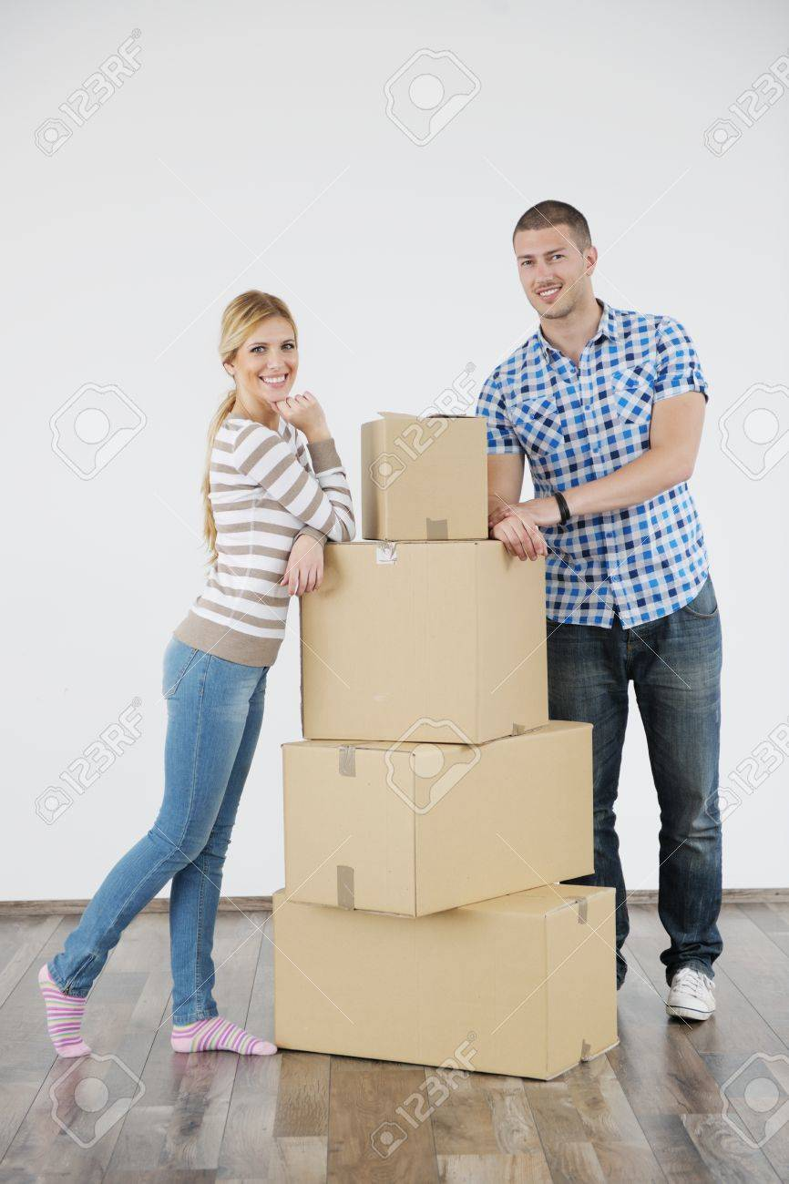 happy Young couple moving in new home Stock Photo - 13775296
