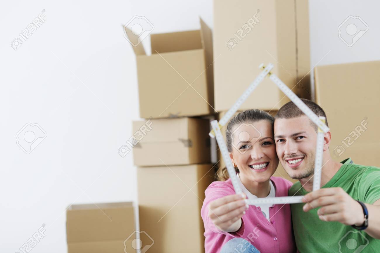 happy Young couple moving in new home Stock Photo - 13775276
