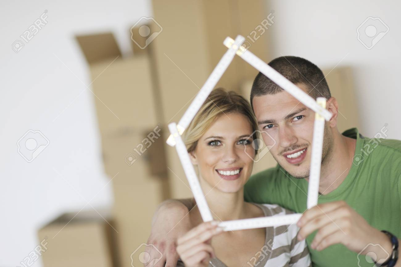 happy Young couple moving in new home Stock Photo - 13909092