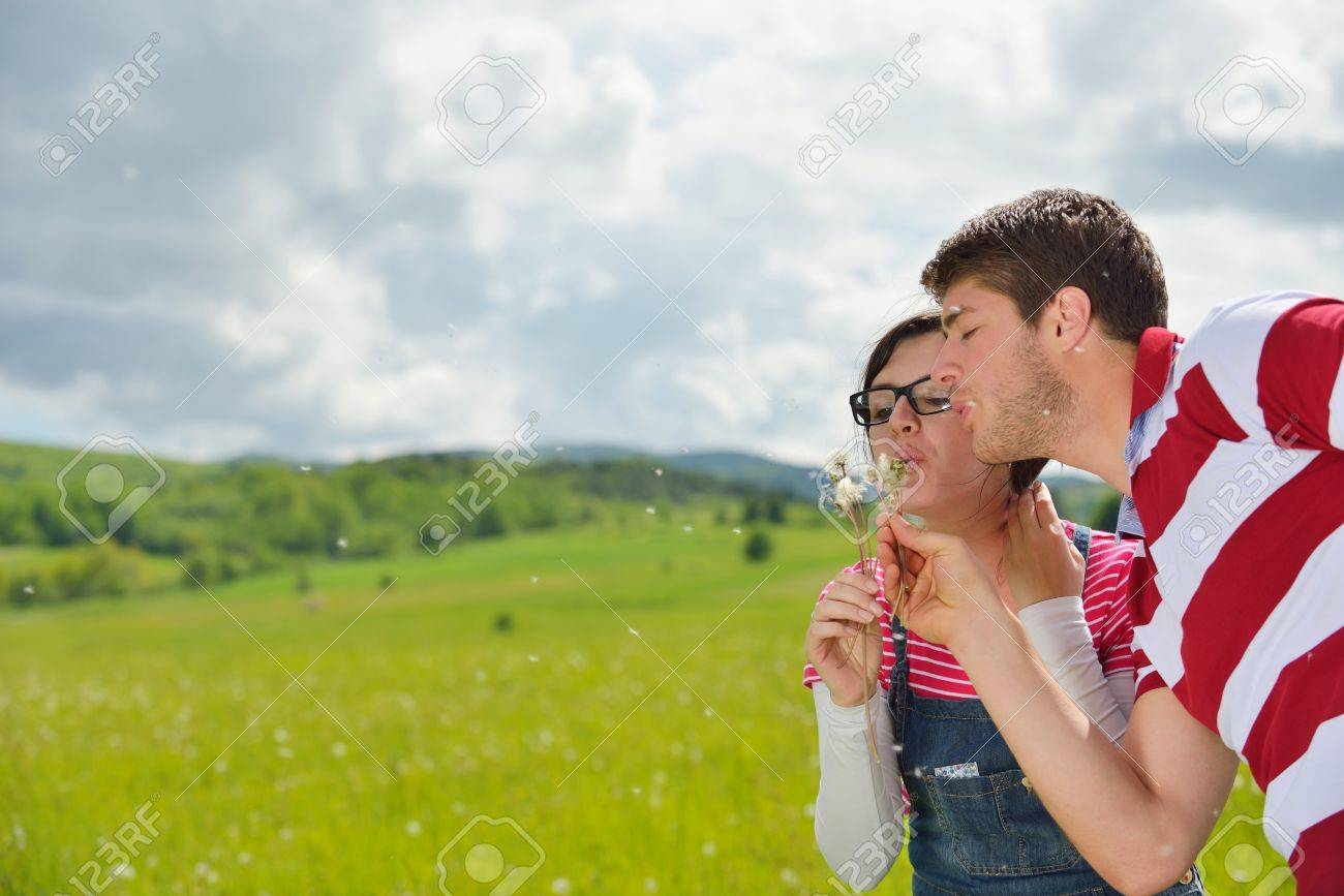 Portrait of romantic young couple in love  smiling together outdoor in nature with blue sky in background Stock Photo - 14670726