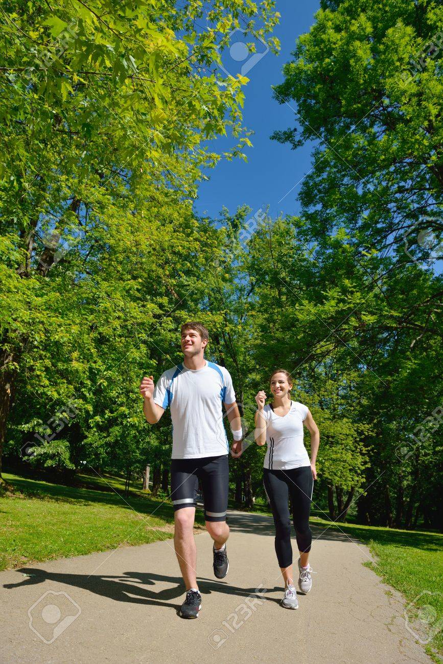 Young couple jogging in park at morning. Health and fitness. Stock Photo - 14703526