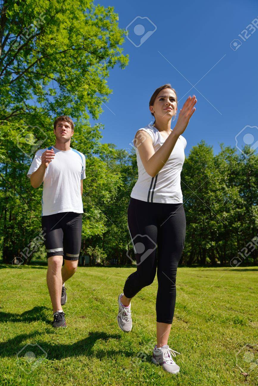 Young couple jogging in park at morning. Health and fitness concept Stock Photo - 15241802