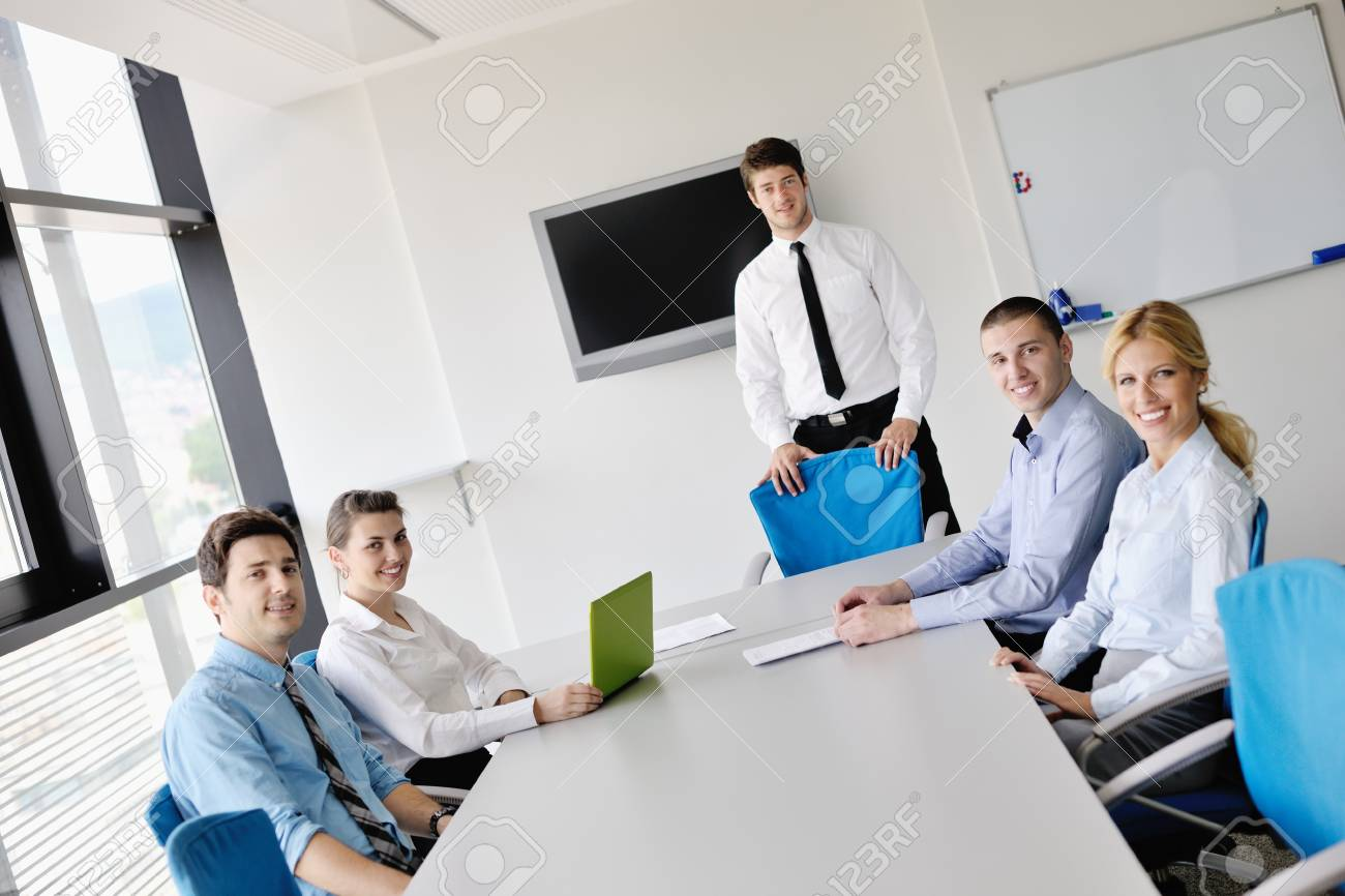 Group of happy young  business people in a meeting at office Stock Photo - 15276661