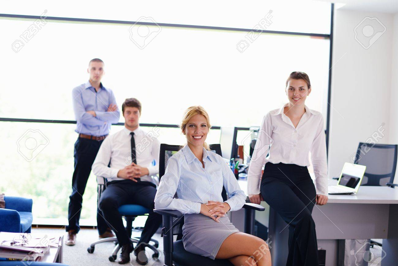 business woman  with her staff,  people group in background at modern bright office indoors Stock Photo - 15301077