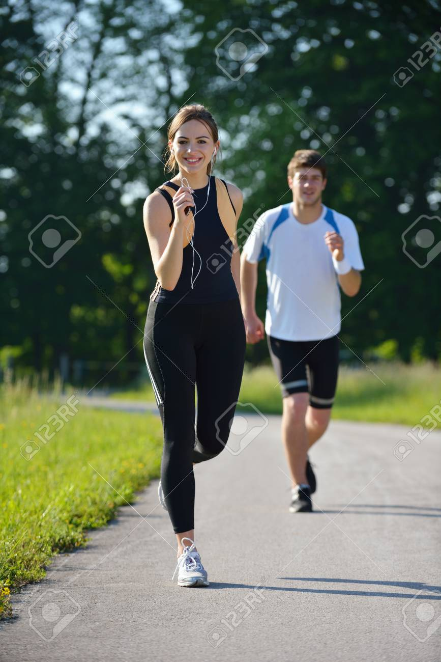 Young couple jogging in park at morning. Health and fitness concept Stock Photo - 15512196