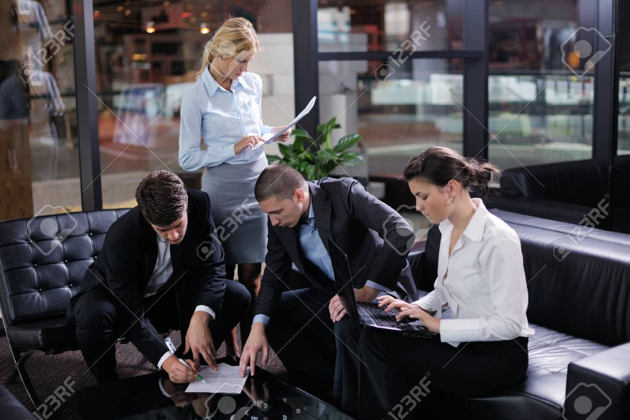 Group of happy young  business people in a meeting at office Stock Photo - 15558973