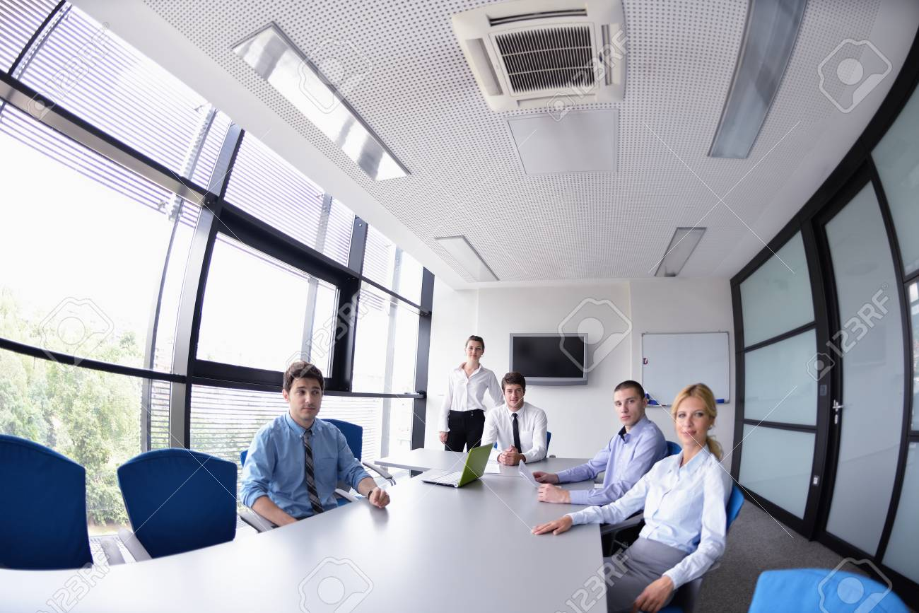 Group of happy young  business people in a meeting at office Stock Photo - 15528328